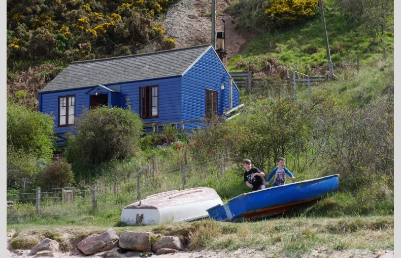 Blue Cabin by the Sea - Image 1